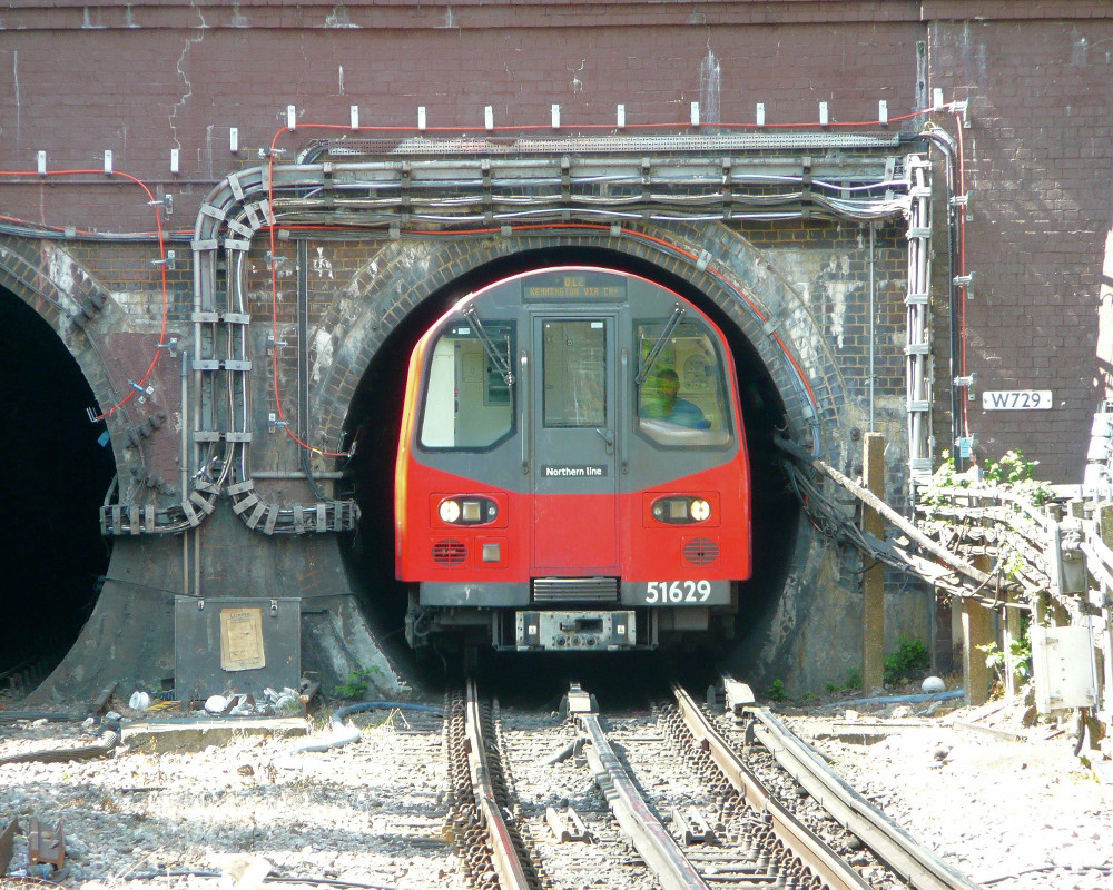 Image of a London tube train exiting a tunnel
