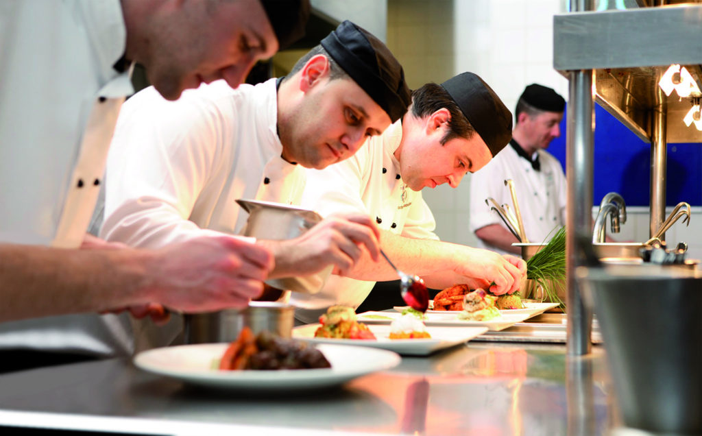 Photograph of chefs preparing meals
