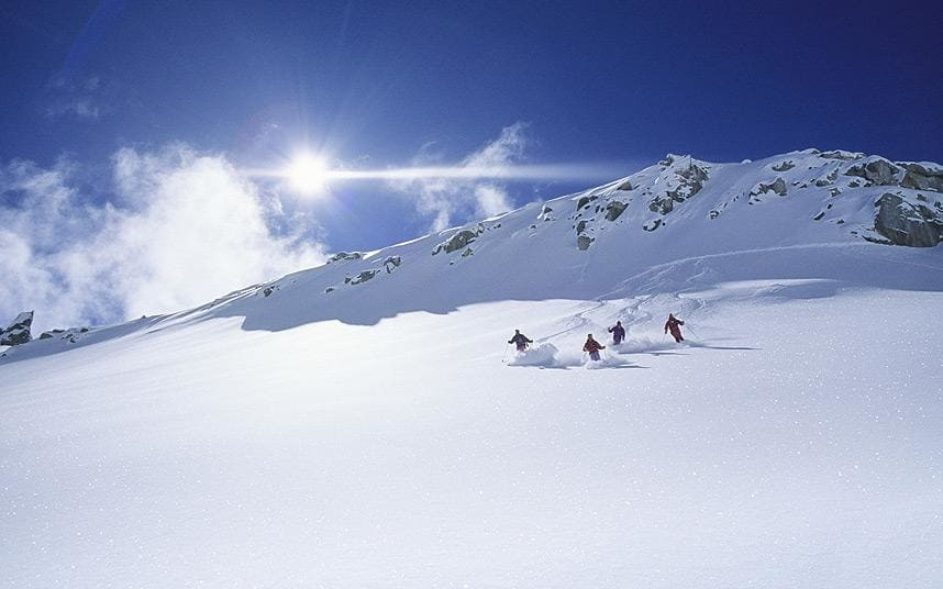 Image of skiers on a mountain